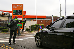 © Licensed to London News Pictures. 08/10/2021. London, UK. A motorist arrives at Sainsbury's petrol station in north London as Sainsbury's has increased the price of unleaded petrol and diesel by 3 pence per litre. The recent UK petrol supply crisis was caused by a shortage of HGV drivers, following the coronavirus pandemic and Brexit. Experts are predicting that motor fuel prices in the UK could reach an all-time high in the run-up to Christmas. Photo credit: Dinendra Haria/LNP