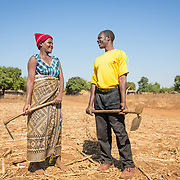 CAPTION: Most of Velinasi and Fidelis' day is spent together. When they work in the fields, they do so side by side. When the children come home from school, they assist their parents in the field. LOCATION: Nsanja-Seze, Vila Ulongwe area, Angonia District, Tete Province, Mozambique. INDIVIDUAL(S) PHOTOGRAPHED: Velinasi Kaliofasi (left) and Fidelis Dickson (right).