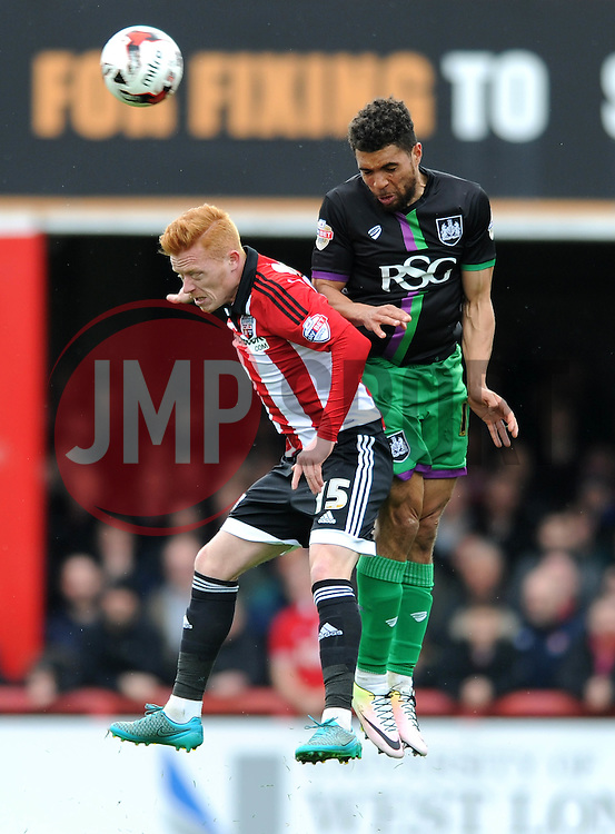 Scott Golbourne of Bristol City challenges for the header with Ryan Woods of Brentford - Mandatory by-line: Dougie Allward/JMP - 16/04/2016 - FOOTBALL - Griffin Park - Brentford, England - Brentford v Bristol City - Sky Bet Championship