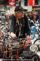 Rene van Tuil of Revatu Customs in Eck en Wiel, Netherlands with his air powered Honda 98cc 4-stroke with compressor pump 2-wheeled oddity that was on display in the AMD World Championship of Custom Bike Building in the custom themed Hall 10 at the AMD World Championship of Custom Bike Building show in the custom dedicated Hall 10 at the Intermot Motorcycle Trade Fair. Cologne, Germany. Saturday October 8, 2016. Photography ©2016 Michael Lichter.