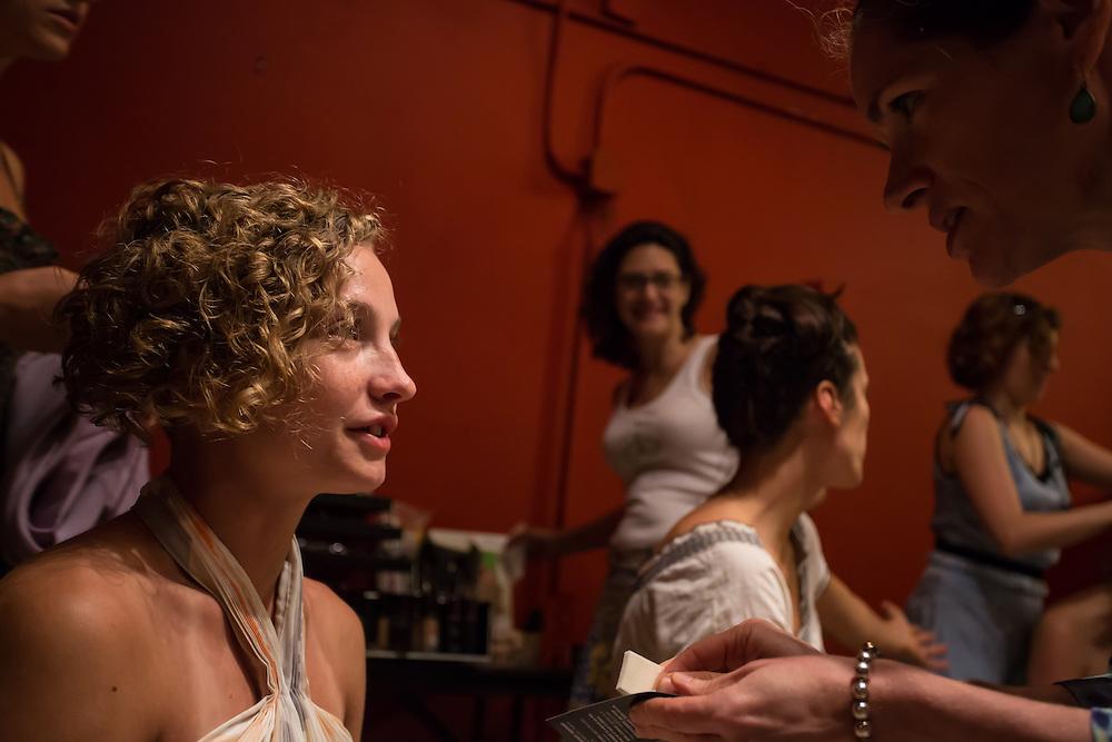 A dancer gets makeup.