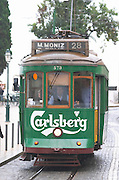 Old tram. Carlsberg publicity. At Miradouro de Santa Luzia. Street view. Alfama district. Lisbon, Portugal