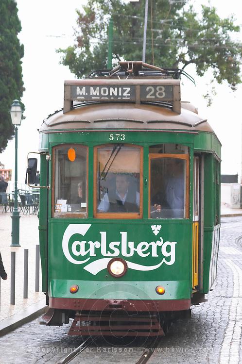 Old tram. Carlsberg publicity. At Miradouro de Santa Luzia. Street view. Alfama district. Lisbon, Portugal