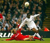Photo: Scott Heavey.<br /> Middlesbrough v Bolton Wanderers. Carling Cup Final. 29/02/2004.<br /> Gaizka Mendieta slides in on JayJay Okocha