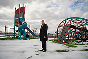 Quincy Natay, Superintendent of Chinle Unified School District stands for a portrait outside of the elementary school in Chinle AZ.  The playground was recently upgraded, but no students  have been able to enjoy the equipment due to the COVID-19 pandemic.