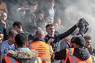 The Bolton Wanderers' fans let off another smoke bomb after their team go 2-0 up and ensure all three points, being on the brink of promotion during the EFL Sky Bet League 1 match between Port Vale and Bolton Wanderers at Vale Park, Burslem, England on 22 April 2017. Photo by Mark P Doherty.