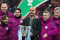 Football - 2018 Carabao (EFL/League) Cup Final - Manchester City vs. Arsenal<br /> <br /> Pep Guardiola, Manager of Manchester City, with his coaching team and the trophy at Wembley.<br /> <br /> COLORSPORT/DANIEL BEARHAM