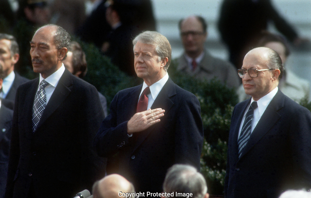 A 27MG IMAGE OF:..Jimmy Carter, Anwar Sadat and Menachen Begin at the signing of the Middle East Peace Agreement  in March 1979..Photo by Dennis Brack