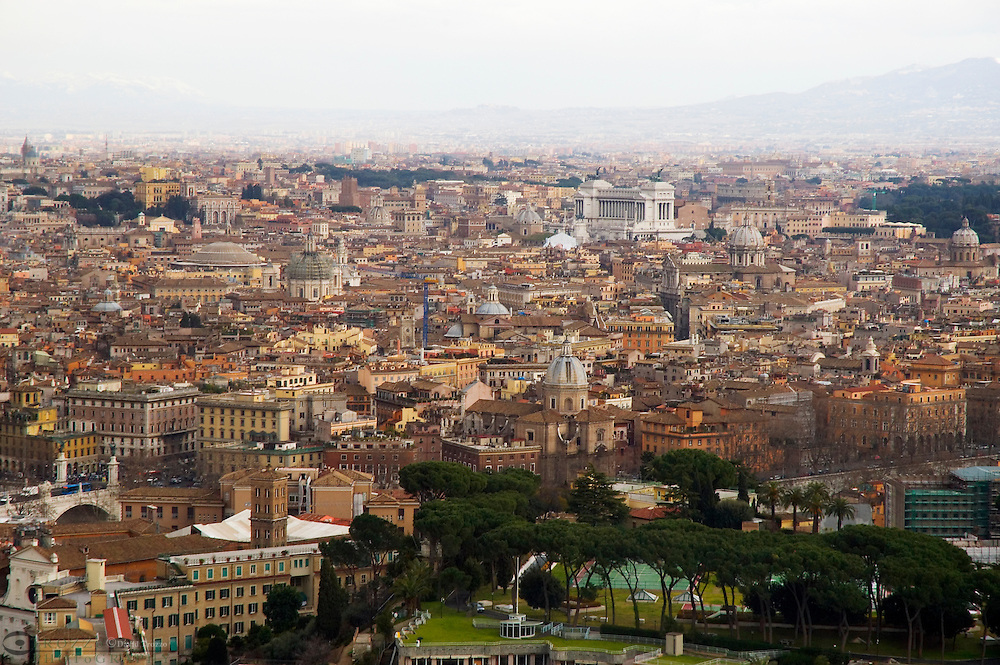 The aeriel view of Rome, Italy, from the copula of the Basilica of St. Peter, Vatican City. The copula of the Basilica of St. Peter is the dominant feature of the Roman skyline.