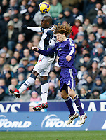 Photo: Steve Bond/Richard Lane Photography. West Bromwich Albion v Newcastle United. Barclays Premiership. 07/02/2009. Marc-Antoine Fortune (L) and Fabricio Coloccini (R) challange in the air
