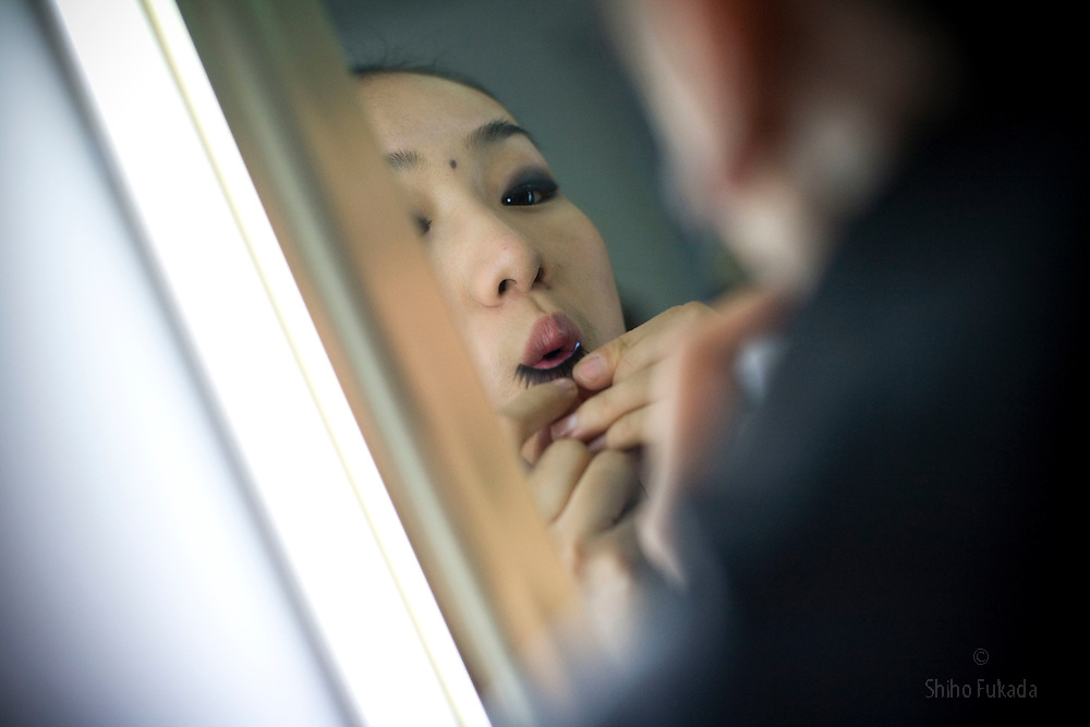 """A participant of """"Miss. International"""" beauty contest puts on makeup before the show in Beijing, China, Nov. 7, 2009. Photo by Shiho Fukada"""