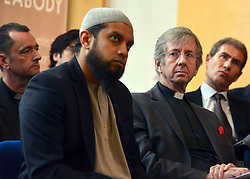 © Licensed to London News Pictures. 24/05/2013. London, UK The Iman of Ebrahim College, Sheikh Shams ad-Duha Muhammad (centre) sits with Rev Guy Wilkinson of Faith Forum 4 London.  Nick Clegg, Liberal Democrat MP and Deputy Prime Minister, attends a multi faith gathering with the local multi faith community at the Hugh Cubitt Peabody Centre in Islington London today 24th May 2013. After meeting privately with political and faith leaders he and they made speeches in response to the attack and death of Drummer Lee Rigby in Woolwich, calling for the community to unite against the attack. Photo credit : Stephen Simpson/LNP