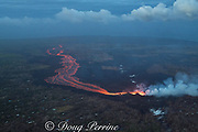 lava erupting from fissure 8 of the Kilauea Volcano east rift zone in Leilani Estates subdivision, near Pahoa, flows downslope as a glowing river of hot lava into Kapoho, lower Puna District, Hawaii Island ( the Big Island ), Hawaiian Islands, U.S.A. ( Pacific Ocean )