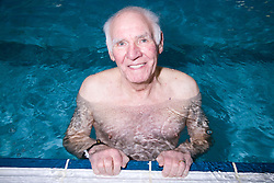 Older man in the swimming pool at his local leisure centre,