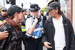 """© Licensed to London News Pictures . 24/06/2017. London, UK. EDL leader IAN CROSSLAND argues with an anti fascist on Whitehall . The English Defence League ( EDL ) hold a March on Parliament , from Charing Cross to Victoria Embankment , opposed by  a counter demonstration by Unite Against Fascism . Scotland Yard said it was using public order laws to restrict the marches """"due to concerns of serious public disorder, and disruption to the community"""" following terrorist attacks in Manchester , Westminster and Finsbury Park and the Grenfell Tower fire  . Photo credit: Joel Goodman/LNP"""