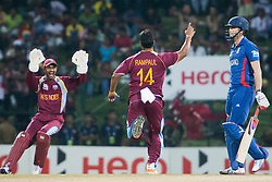 © Licensed to London News Pictures. 27/09/2012. West Indian bowler Ravi Rampaul celebrates after getting the wicket of Craig Kieswetter for a duck during the T20 Cricket World super 8's match between England Vs West Indies at the Pallekele International Stadium Cricket Stadium, Pallekele. Photo credit : Asanka Brendon Ratnayake/LNP