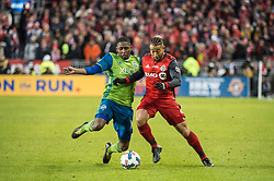 December 9, 2017 - Toronto, Ontario, Canada - Toronto FC defender JUSTIN MORROW (2) and Seattle Sounders defender KELVIN LEERDAM (18) fight for the ball during the MLS Cup championship match at BMO Field in Toronto, Canada.  Toronto FC defeats Seattle Sounders 2 to 0. (Credit Image: © Mark Smith via ZUMA Wire)