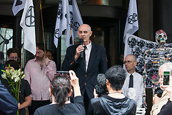 London, UK. 19 July, 2019. Donnachadh McCarthy, author, environmental auditor and green lifestyle coach,  addresses climate activists from Extinction Rebellion taking part in a 'Requiem For A Dead Planet: Newspapers Tell The Truth' event outside the offices of the Daily Mail, Mail on Sunday, Evening Standard and Independent newspapers in Kensington on the fifth day of their 'Summer Uprising' to call for the media to 'tell the truth' regarding the climate crisis, to cease publishing articles by discredited climate change deniers and advertising and editorial promoting a high-carbon lifestyle and to declare a climate and ecological emergency.
