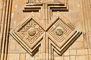 """picture & image of extrior stone work decorations of the Samtavisi Georgian Orthodox Cathedral, 11th century, Shida Karti Region, Georgia (country)<br /> <br /> Built during the so called 10-11th century """"Georgian Golden Era"""" Samtavisi cathedral is a built in classical Georgian style of the period. Layout on a cruciform ground plan with a high central cylindrical central cupola. .<br /> <br /> Visit our MEDIEVAL PHOTO COLLECTIONS for more   photos  to download or buy as prints https://funkystock.photoshelter.com/gallery-collection/Medieval-Middle-Ages-Historic-Places-Arcaeological-Sites-Pictures-Images-of/C0000B5ZA54_WD0s<br /> <br /> Visit our REPUBLIC of GEORGIA HISTORIC PLACES PHOTO COLLECTIONS for more photos to browse, download or buy as wall art prints https://funkystock.photoshelter.com/gallery-collection/Pictures-Images-of-Georgia-Country-Historic-Landmark-Places-Museum-Antiquities/C0000c1oD9eVkh9c"""