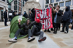 © licensed to London News Pictures. London, UK 01/05/2012. Protesters sitting in a tent as Occupy London protesters gathering at Paternoster Square, outside London Stock Exchange, before their march for May Day in London. Photo credit: Tolga Akmen/LNP
