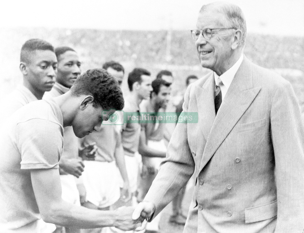 (L-R) Brazil's Garrincha shakes hands with King Gustaf VI Adolf of Sweden before the match. Pele is next to him