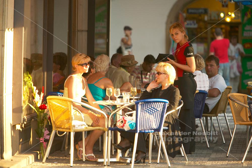 Czeck Republic - Prague, patrons enjoy a summer afternoon in a cafe on the square , Malostranské nám?sti in Malá Strana.
