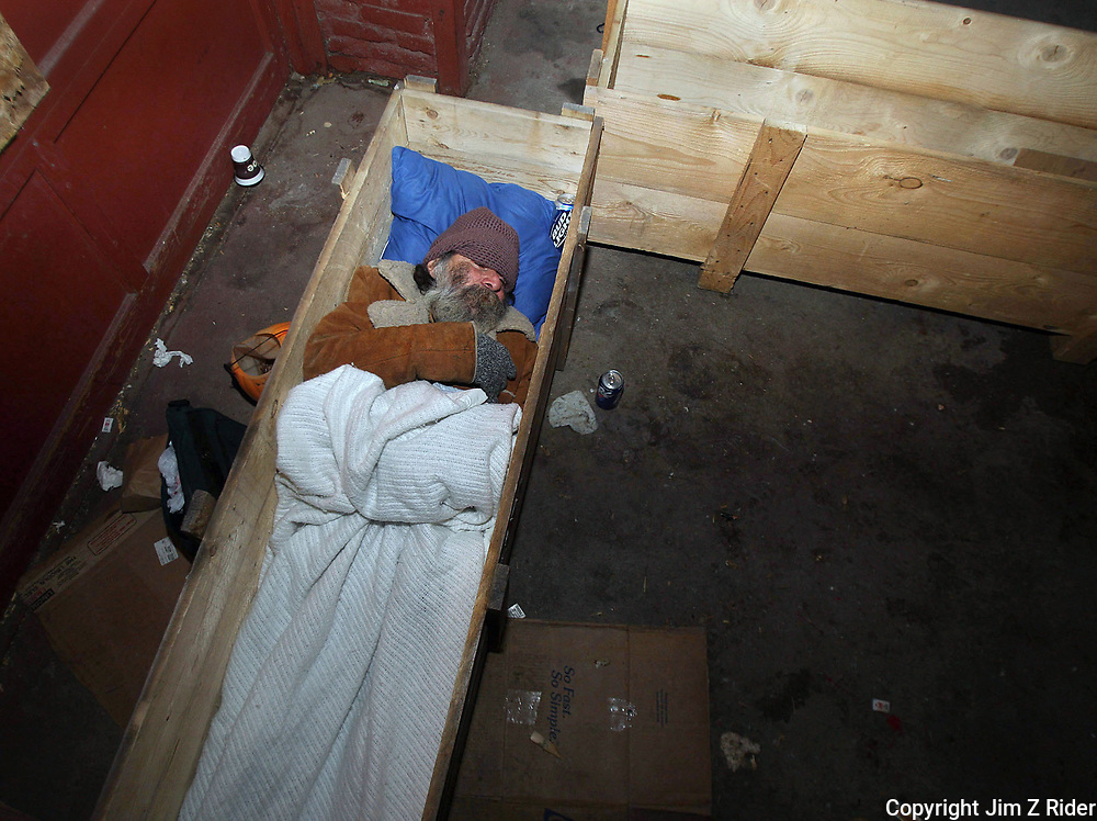 With temperatures dropping into the mid-teens on the night of December 11, 2008, 59-year-old Juan Lopez beds down in an old wooden crate on the shipping dock of a vacant building just south of downtown South Bend.