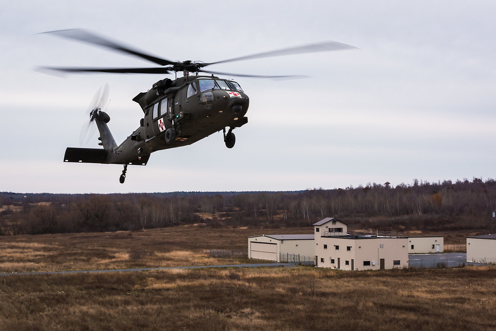 """A HH-60M MEDEVAC black hawk helicopter belonging to C Company, 3-10 GSAB is on approach to a simulated """"hot"""" landing zone (LZ) for medical evacuation on 13 November, 2018.  The crews are constantly aware they are targets but will land, unarmed and while taking fire, often refusing to leave until they have recovered all the wounded."""