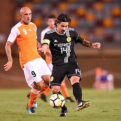 BRISBANE, AUSTRALIA - JANUARY 23: Carlos D Murga of Ceres Negros kicks the ball under pressure from Massimo Maccarone of the Roar during the AFC Champions League Second Preliminary Round match between Brisbane Roar and Ceres Negros FC on January 23, 2017 in Brisbane, Australia. (Photo by Patrick Kearney)