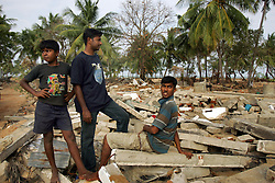 Center, Judeson Britto Moses, who lost his entire immediate family in the tsunami, visits the beach near his wrecked home in the destroyed village of Dutch Bar, Batticaloa, Sri Lanka, Jan. 16, 2005. ÒI am afraid of the beach now,Ó said Moses. Residents of the small Christian village spent more than six weeks in a makeshift refugee camp at the local convent recovering from the devastating tsunami that hit the eastern and southern borders of Sri Lanka. They were then moved into another temporary living camp, while awaiting the building of new homes.