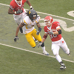 Dec 5, 2009; Piscataway, NJ, USA; Rutgers running back Joe Martinek (38) runs the ball during first half NCAA Big East college football action between Rutgers and West Virginia at Rutgers Stadium.
