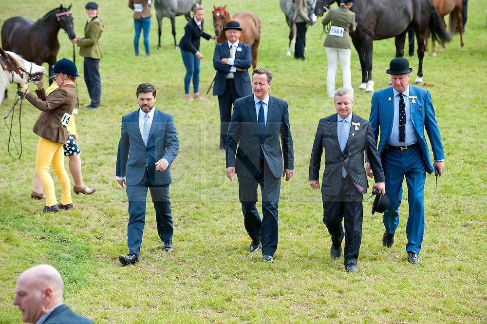 © Licensed to London News Pictures. 23/07/2015. Llanelwedd, Powys, UK.  Secretary of State for Wales Stephen Crabb MP and British prime minister David Cameron visits the Royal Welsh Show. The Royal Welsh Agricultural Show is hailed as the largest & most prestigious event of it's kind in Europe. In excess of 200,000 visitors are expected this week over the four day show period - 2014 saw 237,694 visitors, 1,033 tradestands & a record 7,959 livestock exhibitors. The first ever show was at Aberystwyth in 1904 and attracted 442 livestock entries. Photo credit: Graham M. Lawrence/LNP