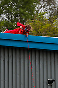 """Leicester, United Kingdom, May 20, 2021: An activist pours colour on the entrance side of the Elbit subsidiary UAV Tactical Systems during a """"Stop Bombing Gaza"""" protest campaign in Leicester on Thursday, May 20, 2021.UK based Pro-Palestinian activists' group """"Palestine Action"""" who seized control of the Leicester based factory of Elbit subsidiary UAV Tactical Systems on Wednesday, continue to occupy its rooftop for the 2nd day with activists saying that """"the occupation is aiming to be as disruptive as possible; these activists are determined to prevent Elbit from resuming its business of bloodshed."""" A dozen people waving Palestinian flags and """"STOP BOMBING GAZA"""" placards have gathered outside the factory in support of activists standing on the rooftop. (Photo by Vudi Xhymshiti/VXP)"""