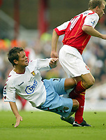 16/10/2004<br />FA Barclays Premiership - Arsenal v Aston Villa - HIghbury<br />Aston Villa's firey Lee Hendrie flies into the back of Arsenal's Dennis Bergkamp<br />Photo:Jed Leicester/BPI (back page images)