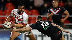 St Helens Saints' Dominique Peyroux is tackled by London Broncos' Matt Gee, during the Betfred Super League match at the Totally Wicked Stadium, St Helens.