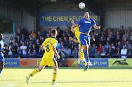 Oxford United attacker Jamie Mackie (19) fouling AFC Wimbledon defender Rod McDonald (26) during the EFL Sky Bet League 1 match between AFC Wimbledon and Oxford United at the Cherry Red Records Stadium, Kingston, England on 29 September 2018.