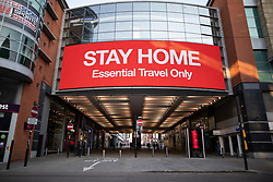 "© Licensed to London News Pictures. 26/03/2020. Manchester, UK. A large digital display bears the message "" STAY HOME Essential Travel Only "" on Market Street . Manchester City Centre lies nearly empty during a sunny spring afternoon . The British government has imposed a lockdown on all but essential activities and instructed people to reduce social contact as part of quarantine measures to prevent the spread of Coronavirus ( COVID-19 ) . Photo credit: Joel Goodman/LNP"