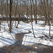 A feeder stream between the D and R canal and the river in the winter snow