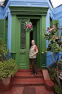 Barranco. Mari Solari on the door of her house and shop Las Pallas