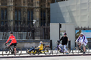 People cycling near Westminster Bridge in London, on Tuesday, May 5, 2020. (Photo/Vudi Xhymshiti)
