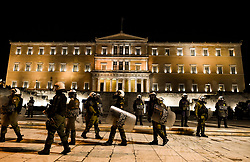Riot police guard in front of the Greek Parliament during a demonstration,  in Athens, Greece on Friday, December. 6, 2019 commemorating the killing of 15-year-old student Alexandros Grigoropoulos by a police officer in 2008. Authorities are closing off main roads and have tightened security in the Greek capital.<br /> <br /> Pictured: <br /> Dimitris Lampropoulos  | EEm date