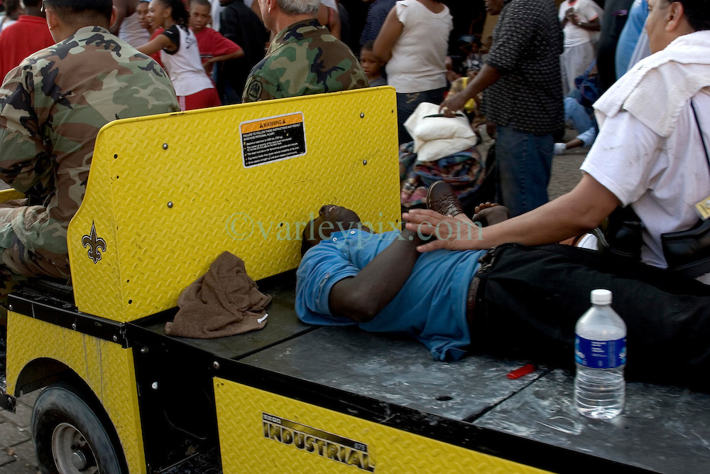 31st August, 2005. New Orleans Louisiana. <br /> Hurricane Katrina.  An injured man is moved from The Superdome, 'Hell on earth,' where over 20,000 refugees from hurricane Katrina are crammed into hellish conditions. <br /> Photo Credit: Charlie Varley/varleypix.com