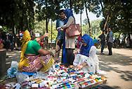 Dhaka, Bangladesh - November 1, 2017: People shop for bracelets from a sidewalk vendor in Dhaka, Bangladesh