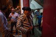 """A Matadores pauses for a moment before entering the bullring at an evening 'Corrida de Touros', on 15th July 2016, at Caldas da Rainha, Portugal. A matador de toros (or """"killer of bulls"""" from Latin mactator, killer, slayer, from mactare, to slay) is considered to be both an artist and an athlete, possessing great agility, grace, and co-ordination. The great personal danger of bullfighting adds to the performing matador's mystique; matadores are regularly injured by bulls and, concurrently, 533 professional bullfighters have been killed in the arena since 1700. In the Portuguese version, unlike Spanish bullfights, the bull is not killed. (Photo by Richard Baker / In Pictures via Getty Images)"""