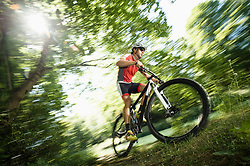 Man mountain biking in Isar footplains, Munich, Germany