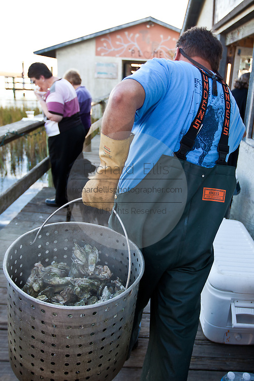 Steaming oysters at Bowen's Island restaurant along the Folly River, Charleston, SC.