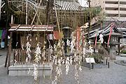 Rokkakudo temple Kyoto with O-mikuji prayers tied to willow tree Japan