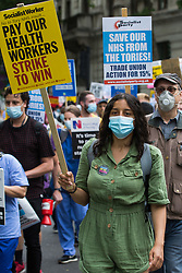 London, UK. 3rd July, 2021. NHS workers and supporters take part in a protest march from University College Hospital to Whitehall as part of a national day of action to mark the 73rd birthday of the National Health Service. The protesters called for fair pay for NHS workers, for better funding of the NHS and for an end to privatisation measures affecting the NHS.