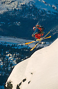Alaska. Kent Kriesler hits the powder snow on a winter day. Skiing in the sunshine.