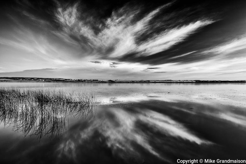 Clouds reflected in Saskatoon Lake<br />Saskatoon Lake Provincial Park<br />Saskatchewan<br />Canada